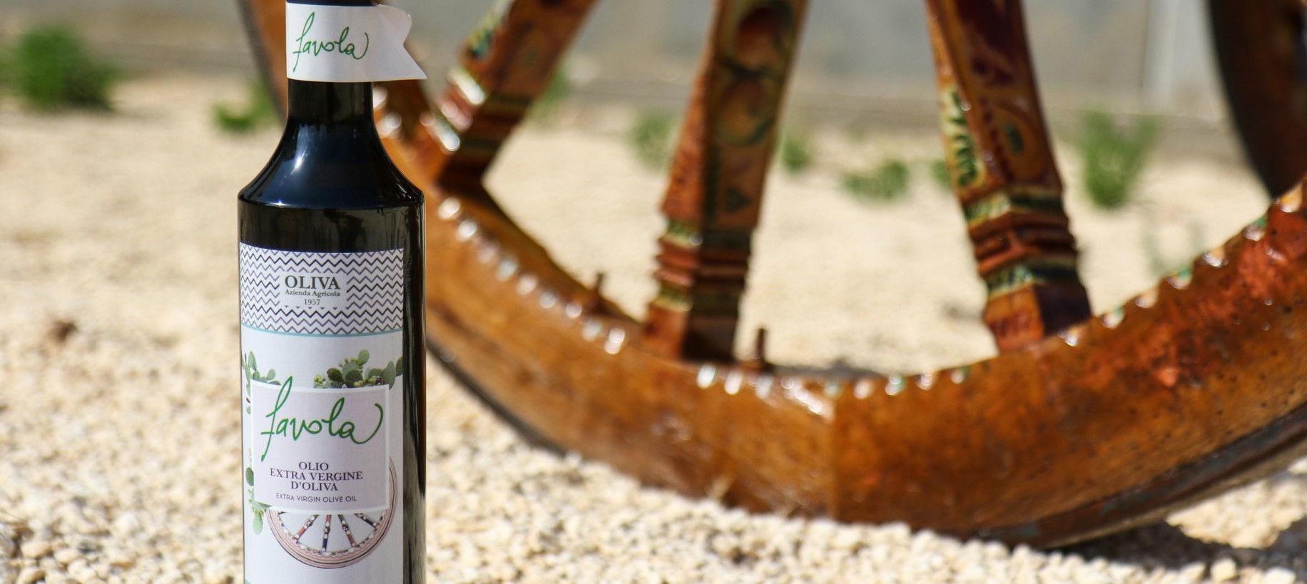 carretto e bottiglia olio favola - Azienda Agricola Oliva